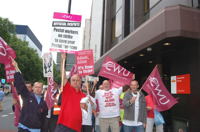 Determined postal workers demonstrating outside Royal Mail head office in London's Old Street last Friday