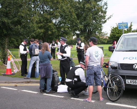 Police stop and search young people near to the Climate Change camp at Heathrow Airport