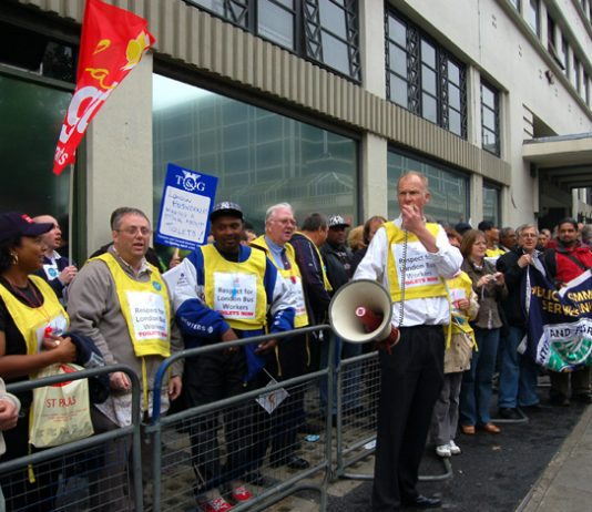Busworkers protesting outside Victoria Coach Station in London yesterday against their appalling working conditions