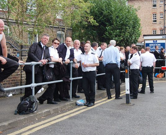 Striking prison officers outside Brixton prison yesterday