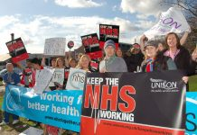 Health workers demonstrating against cuts outside Kingston Hospital in March this year