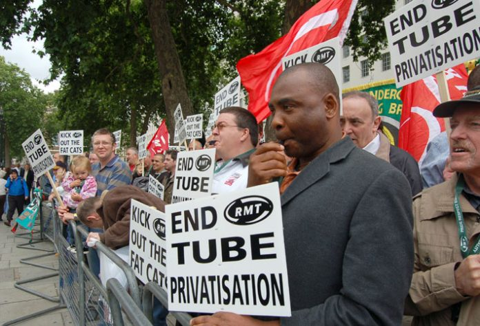 RMT members demonstrate opposite Downing St in July after the collapse of Metronet, demanding tube maintenance be taken back 'in-house'. PM Brown refused