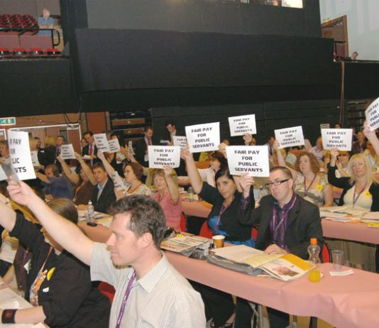 A section of delegates at the TUC Congress greet Brown with their placards