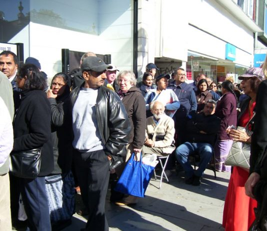 Section of the hundreds of depositors who were queuing outside Northern Rock bank in Harrow yesterday