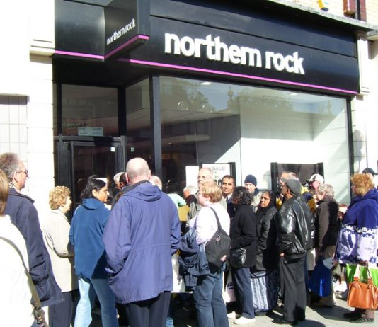 Queue outside the Northern Rock bank in Harruw on Tuesday of savers determined to take out their money