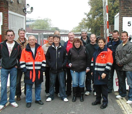 Striking postal workers' picket at the Crawley Delivery Office yesterday morning