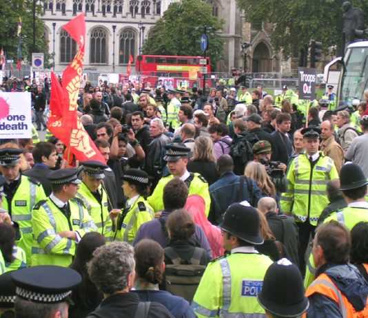 The police lines open and the marchers pour through, heading for a demonstration in Parliament Square, opposite the House of Commons