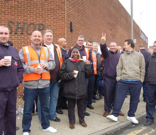 Workers at the Nine Elms Mail Centre in south-west London in determined mood