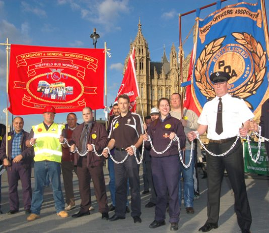 Trade unionists in chains outside the House of Commons yesterday afternoon demanding support for the Trade Union Freedom Bill