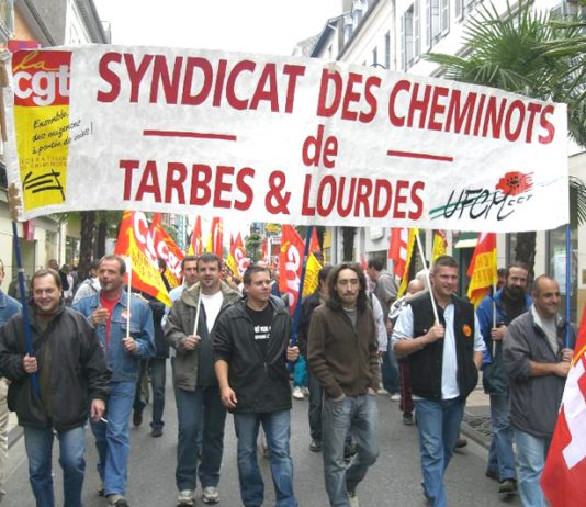 Striking French transport workers marching in Lourdes yesterday