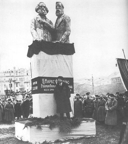 Lenin, leader of the Bolshevik Party, speaking at the dedication of a statue of Marx and Engels in Moscow in 1918, a year after the revolution