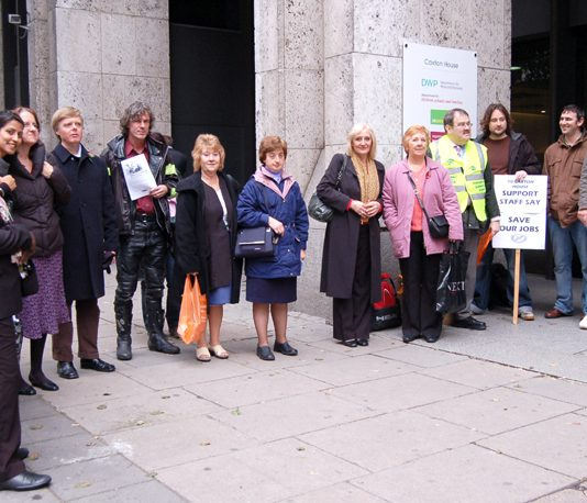 PCS members picket Caxton House in London during Wednesday's strike action against the compulsory transfer of mailroom and security staff to the private sector