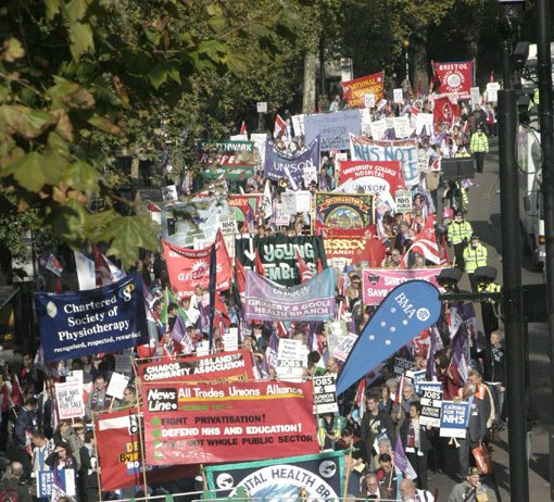 Some of the many banners on Saturday's  NHS Together march as it passed down Victoria Embankment