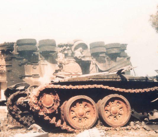 Sri Lankan army vehicles smoulder after a Tamil Tiger assault