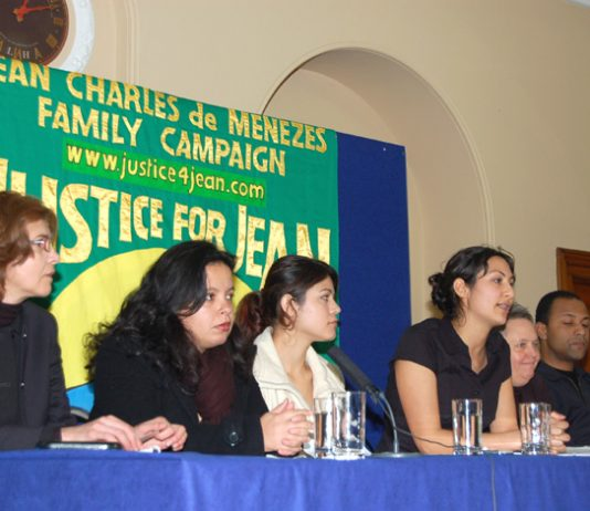 The platform at yesterday's press conference given by the family of Jean Charles de Menezes, including his cousins Patricia da Silva Armani (second from left) and VIvian Figueiredo (third from left)