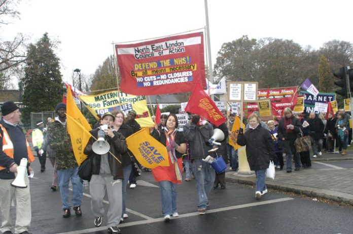 The North East London Council of Action banner leading the march to keep Chase Farm Hospital open