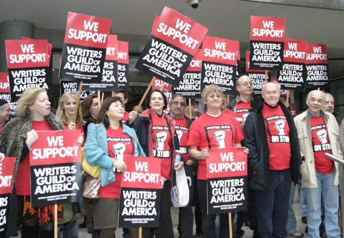 Writers, actors and directors including TIMOTHY WEST (2nd from right) and ALAN PLATER (far right) demonstrating their support yesterday on the steps of the TUC for the US screen writers strike