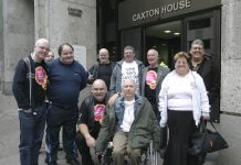 Remploy workers occupying the Department of Work and Pensions head office yesterday, surrounded by police. The protesters demanded that the 28 Remploy factories be kept open