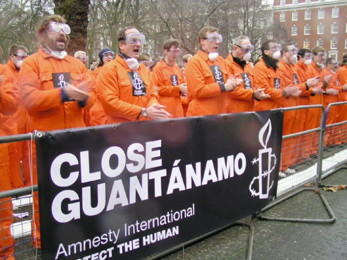 Protest outside the US embassy in London on January 11th this year, 5 years since the first prisoner was interned in Guantanamo Bay
