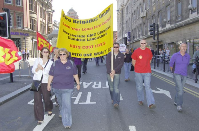 FBU members marching in Liverpool in September last year against the closure of five local fire control centres in the north west of England to be replaced by one regional control