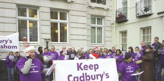 Cadbury's workers singing Christmas carols outside the Cadbury Schweppes headquarters in Berkeley Square yesterday. The company wants to export their jobs to Poland