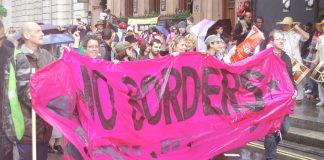 'No Borders' banner on the 'Strangers into Citizens' demonstration on May 7th