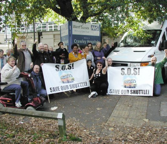 Campaigners outside Crawley Hospital  fighting to defend the shuttle bus service