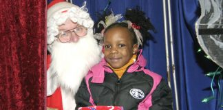 Father Christmas and child at the Young Socialists Christmas Bazaar – many families are having a very tough Christmas because of Scrooge employers
