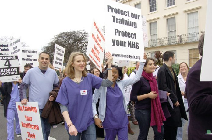 Junior doctors, members of the BMA, demonstrate against the government imposed Medical Training Application Service leaving thousands without posts. The latest government move threatens GPs