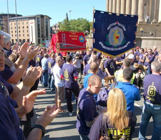 Humberside and Tayside FBU banners on a national FBU demonstration in Liverpool