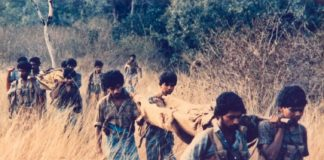 Tamil Tigers carry their wounded to safety