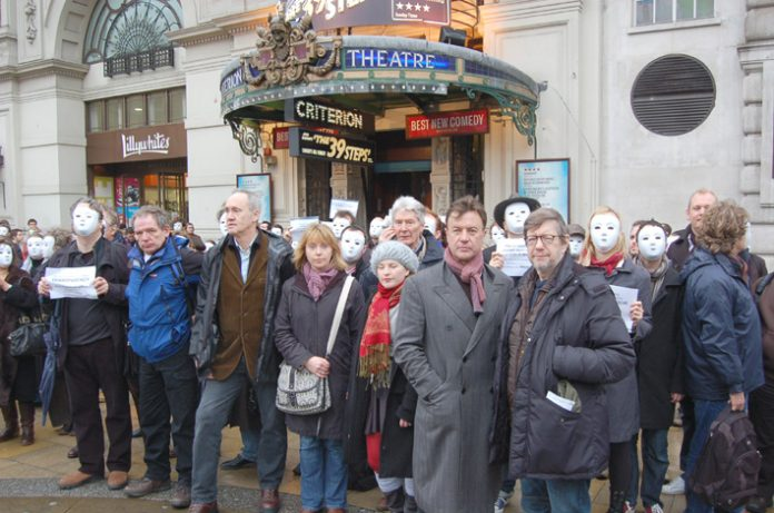 DAVID SCHOFIELD (2nd left) and  NIGEL PLANER (3rd left) amongst more than 500 actors demonstrating last Tuesday  in Piccadilly Circus, London, to protest at the huge cuts being made in the Arts budget
