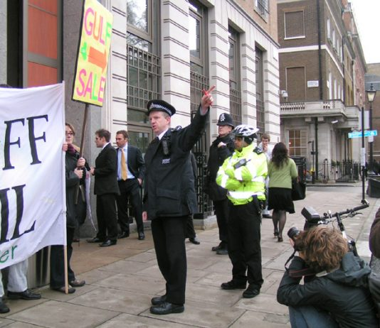 A police officer threatened to arrest the small picket outside the Middle East Energy Conference in London yesterday morning. The demonstrators were urging those coming into the conference to keep their hands off Iraq's oil and that it must not be privati