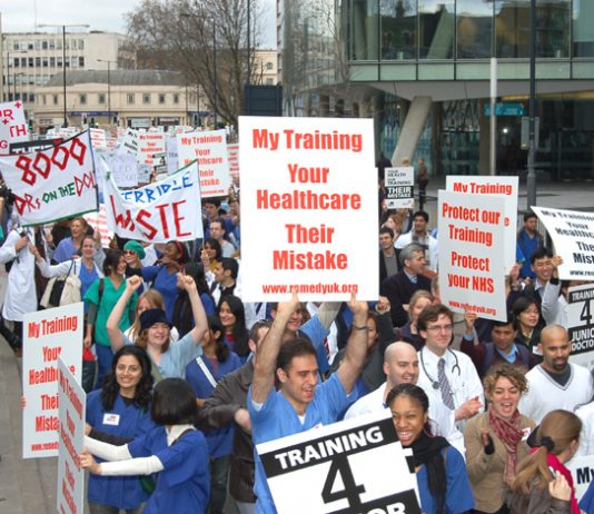 Junior doctors march against the government's disastrous imposition of the Medical Training and Application Service proposals which have left thousands without jobs