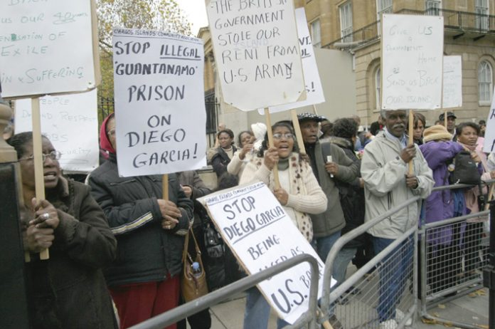 Chagos Islanders demonstrating outside Downing Street last November demanding the right to return to their islands  and the expulsion of the US base from Diego Garcia, the largest of them