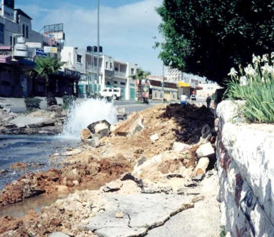 Water main in the Palestinian West Bank  burst by an Israeli army tank