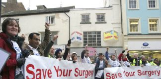 Over fifty GPs, surgery staff and their relatives urged Rugby residents to 'Save Your Surgery'