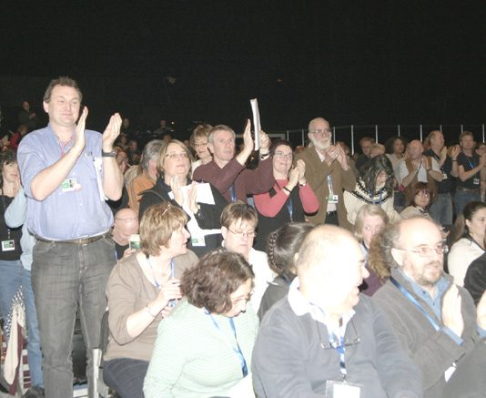 Delegates at the NUT conference show their support for action to defend wages and jobs