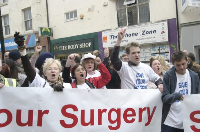 GPs demonstrating in Rugby against private polyclinics
