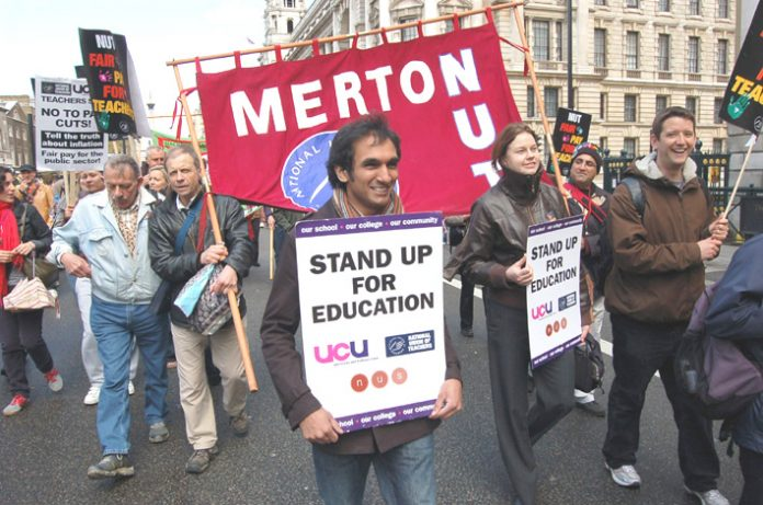 NUT members and UCU lecturers marching together on the 20,000-strong march against pay cuts in London on Thursday