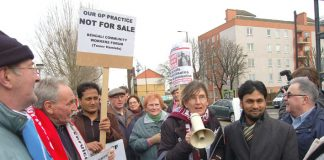 Doctors, local residents and trade unionists demonstrating against the privatisation of GP surgeries in Tower Hamlets