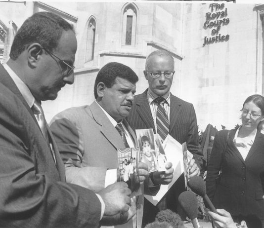 KIFA  MUNTARI (left, now deceased) and Baha Mousa's father DAOUD MOUSA (second left) with lawyers at the High Court in London in 2004, after his son's brutal death at the hands of British troops in southern Iraq