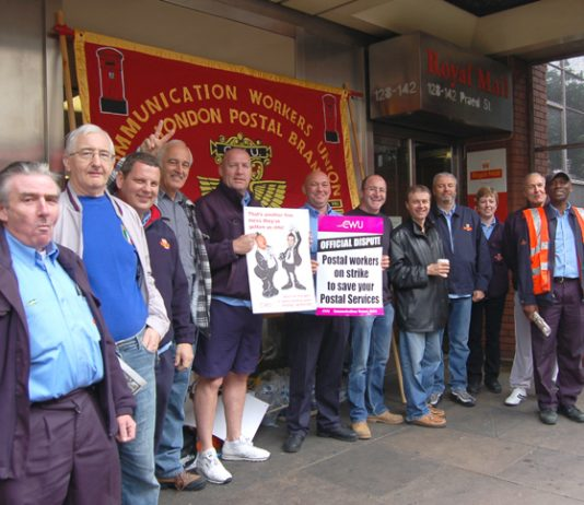 Determined postal workers on the picket line during strike action across Royal Mail last year against pay cuts and attacks on their conditions of service