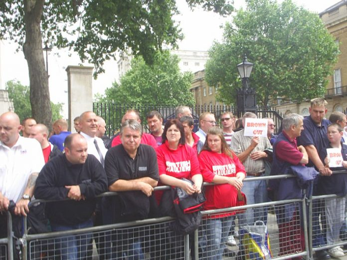 Road hauliers and their families across the road from Downing Street yesterday afternoon