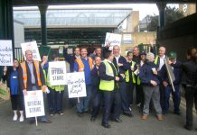 Striking bus workers outside the Ash Grove depot in Hackney yesterday demanding the reinstatement of their steward