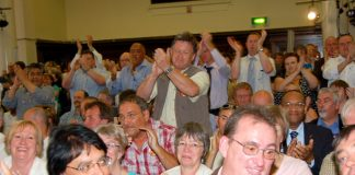 Many trade unionists stood to applaud when Brian Caton said the POA would defy a government strike ban against prison officers and called on all the public sector unions to join them in a one-day strike