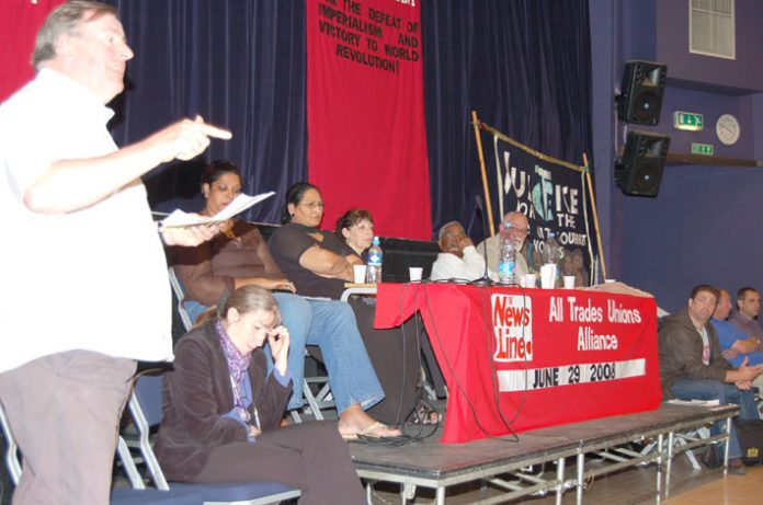 Secretary of the North East London Council of Action Bill Rogers with (from the left) ANNA ATHOW, HENGRIDE PERMAL, LAKHINDER SARAN, SHEILA TORRANCE, DR RAJ and DAVE WILTSHIRE on the platform at the News Line-ATUA Conference on Sunday