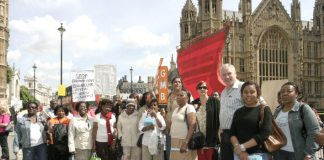 A group of Chagos Islanders outside the Houses of Parliament with GMB official PAUL MALONEY