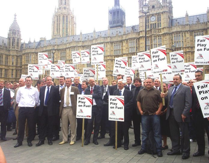 A section of the mass demonstration outside Parliament of road hauliers from throughout the UK demanding Brown act on high fuel prices