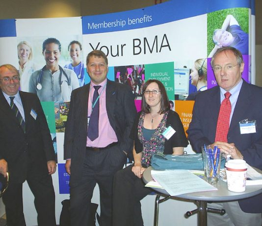A group of BMA representatives happy at the stand their conference is taking in defence of the NHS
